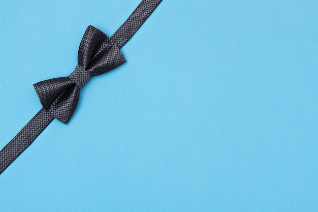 Father's day card background on blue background. composition of tie, bow tie, mustache. father's day Premium Photo