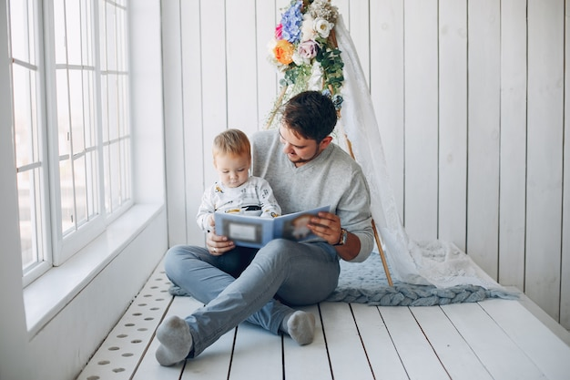 Father sitting at home with little son Free Photo