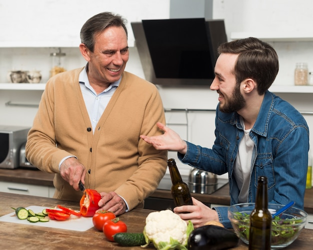 Father and son bonding ion kitchen Free Photo
