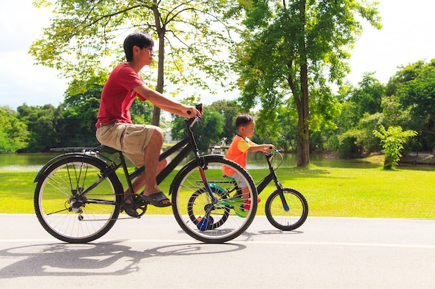 Father and son cycling Premium Photo