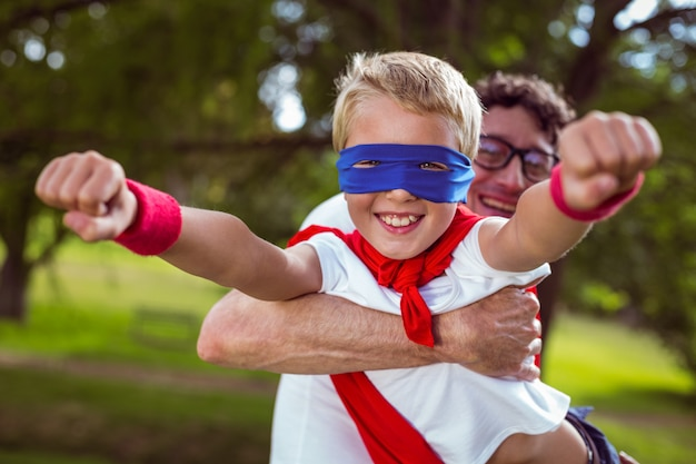 Father and son dressed as superman Premium Photo