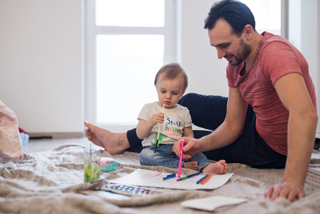 Father and son enjoying creative activities Free Photo