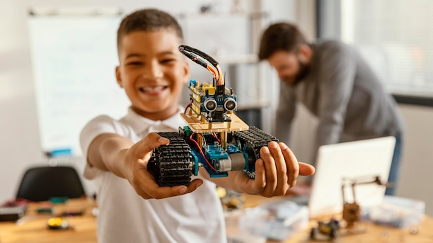 Father and son making robot Free Photo