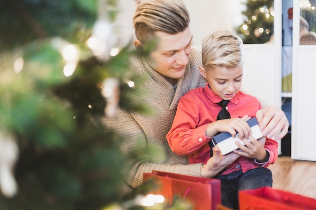Father and son opening presents Free Photo