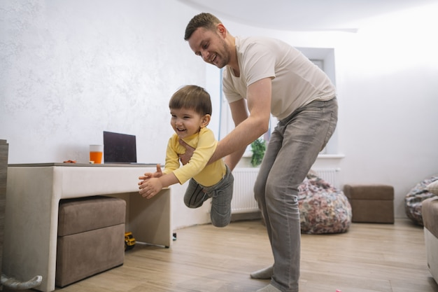 Father and son playing in the living room Free Photo
