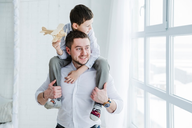 Father and son playing together on fathers day Free Photo