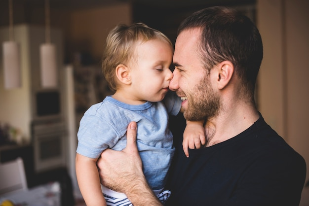 Father and son playing with their noses Free Photo