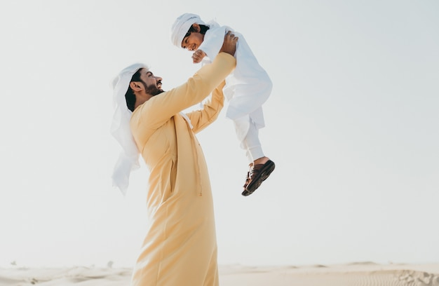 Father and son spending time in the desert Premium Photo