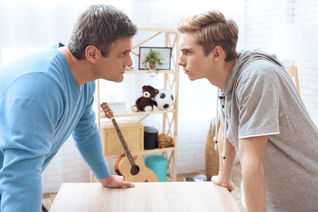 Father and son standing face to face. Premium Photo