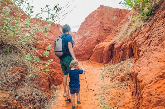 Father and son travelers in red canyon near mui ne, southern vietnam Premium Photo