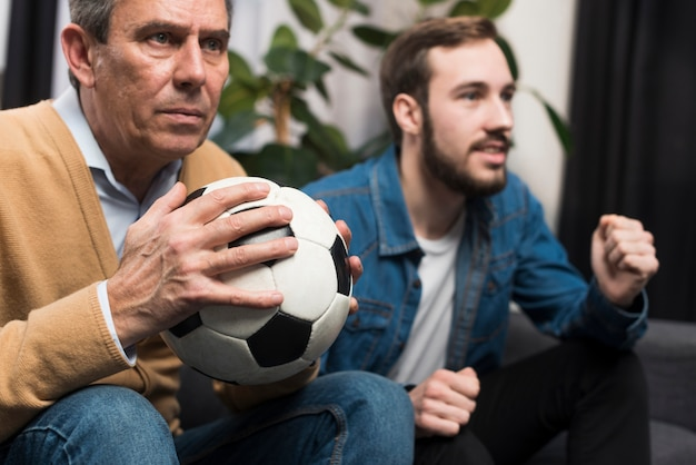 Father and son watching game Free Photo