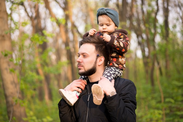 Father with child in nature Free Photo