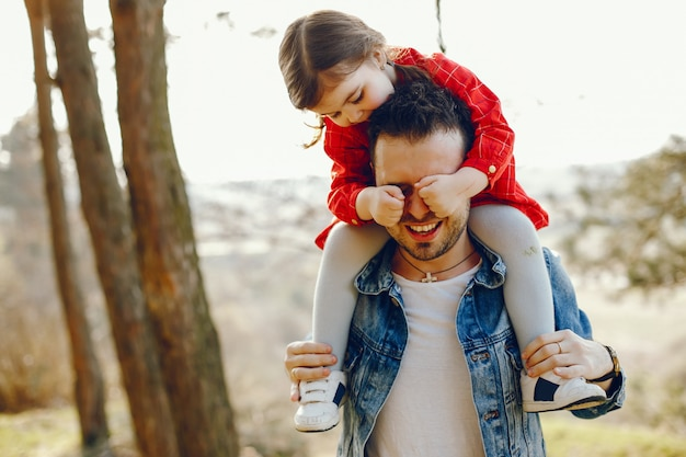 Father with daughter in a forest Free Photo