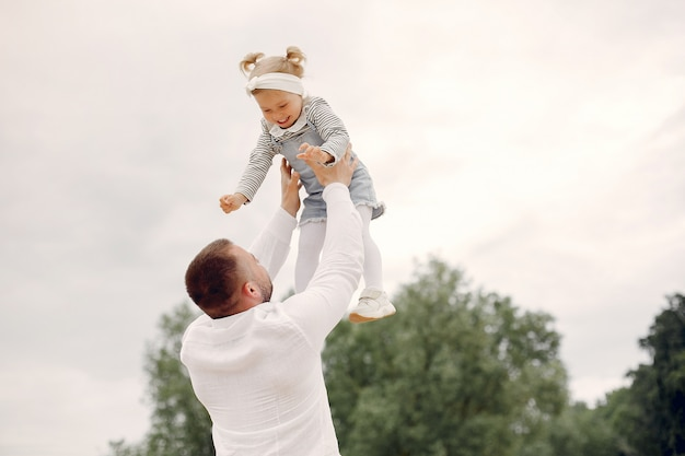 Father with daughter playing in a summer park Free Photo