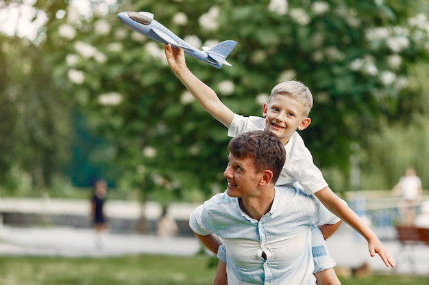 Father with little son playing with toy plane Free Photo