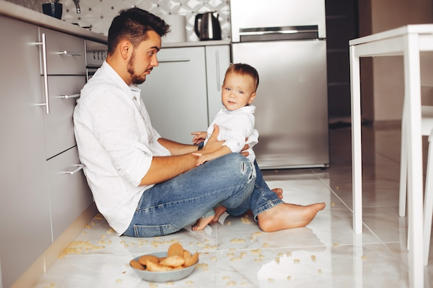 Father with son at home Free Photo