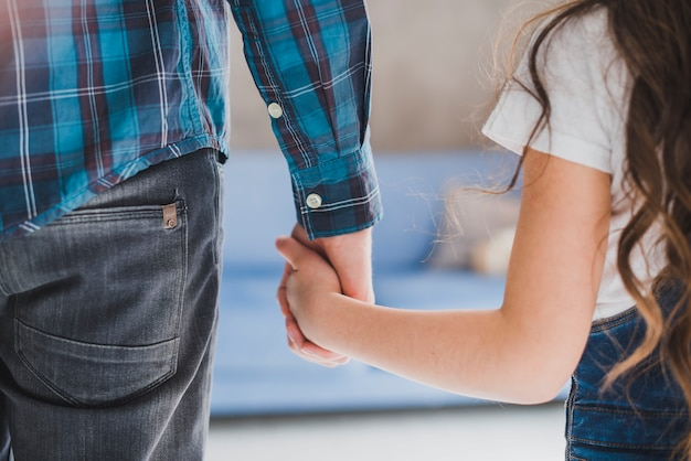 Fathers Day Concept With Father And Daughter Holding Hands Photo