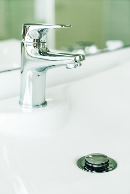 Faucet water in bathroom Free Photo