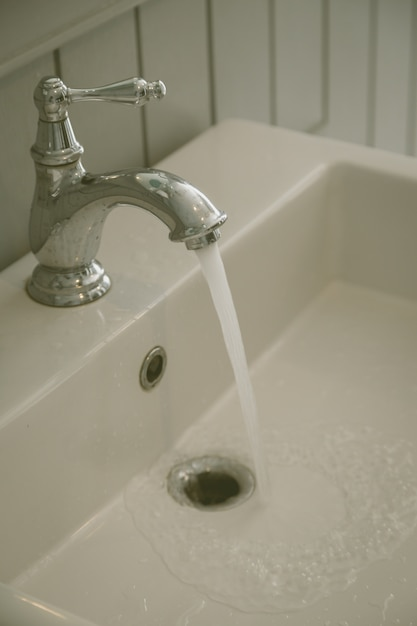 Faucets at toilet background Photo | Premium Download