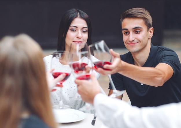 Feast. friends drink wine in a restaurant. Premium Photo