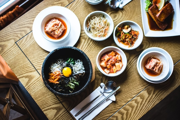 Feasting on bibimbap, kimchi and other traditional korean food Free Photo