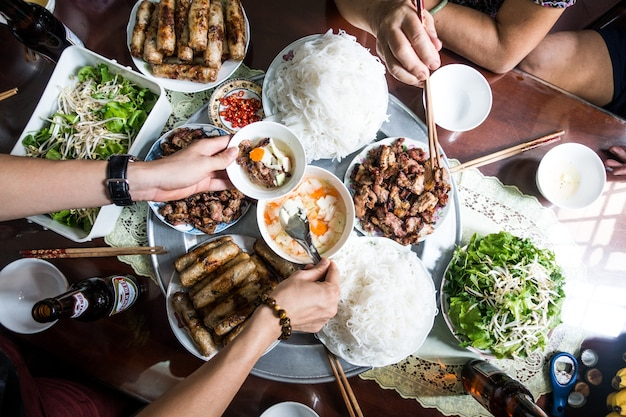 Feasting with family on vietnamese traditional food Free Photo
