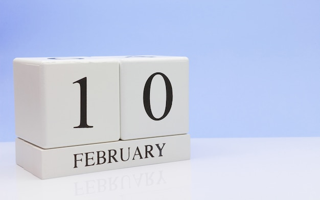 February 10st. day 10 of month, daily calendar on white table. Premium Photo