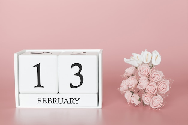 February 13th. day 13 of month. calendar cube on modern pink background, concept of bussines and an importent event. Premium Photo