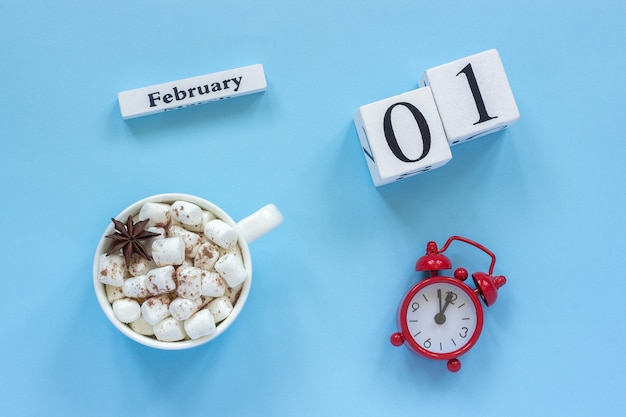 February 1st cup of cocoa with marshmallows and alarm clock Premium Photo