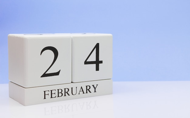 February 24st. day 24 of month, daily calendar on white table. Premium Photo