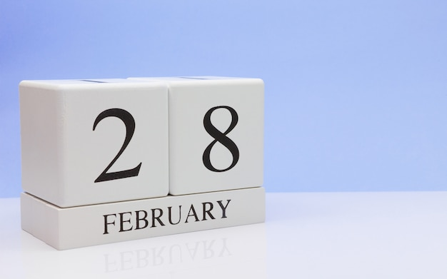 February 28st. day 28 of month, daily calendar on white table. Premium Photo
