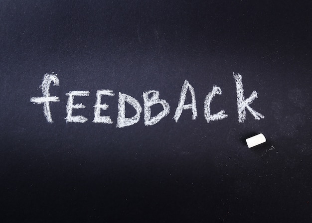 Feedback word written with chalk in a blackboard Free Photo
