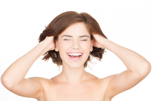 Feel the freshness. horizontal portrait of a young woman laughing and touching her hair Premium Photo
