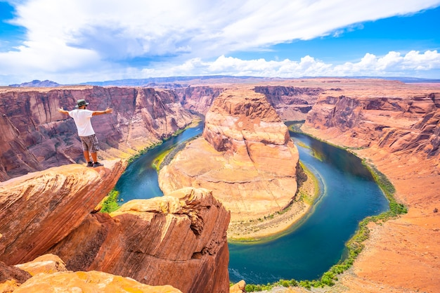 Feet are seen sitting down watching horseshoe bend, arizona. united states Premium Photo