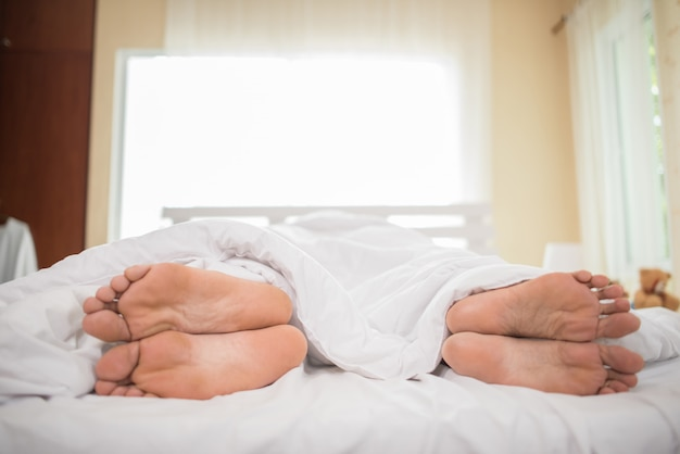 Feet of couple facing away from each other. Free Photo