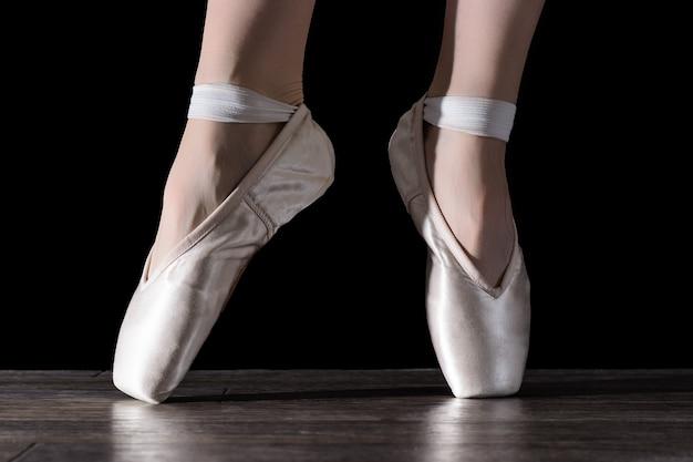 Feet of dancing ballerina. Premium Photo