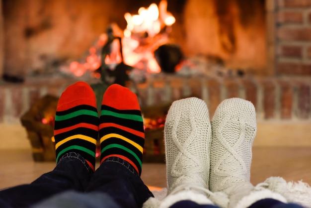 Feet in christmas socks near fireplace Photo   Free Download