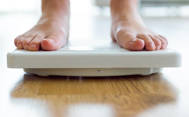 Feet on a scale Premium Photo