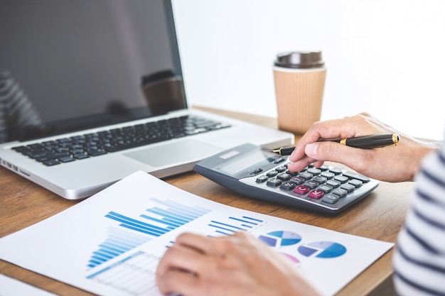 Female accountant calculations, audit and analyzing financial graph data Premium Photo