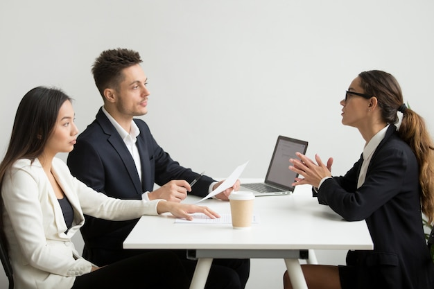 Female applicant interviewed by hr mangers Free Photo