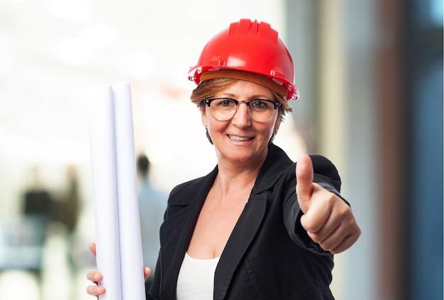 Female architect with thumb up Free Photo
