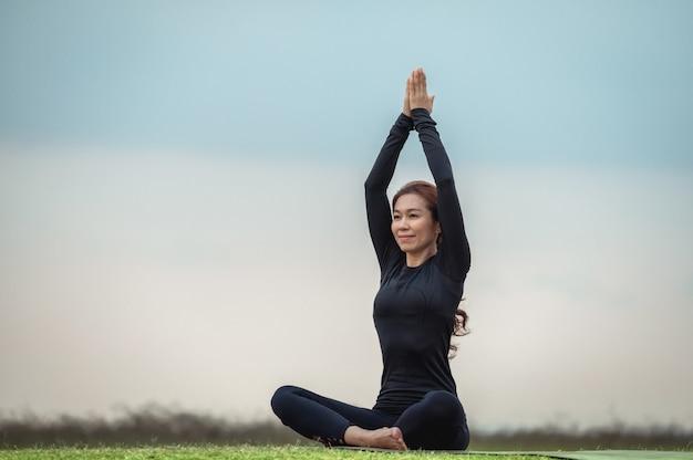 Premium Photo | Female asian yoga meditation in the open field