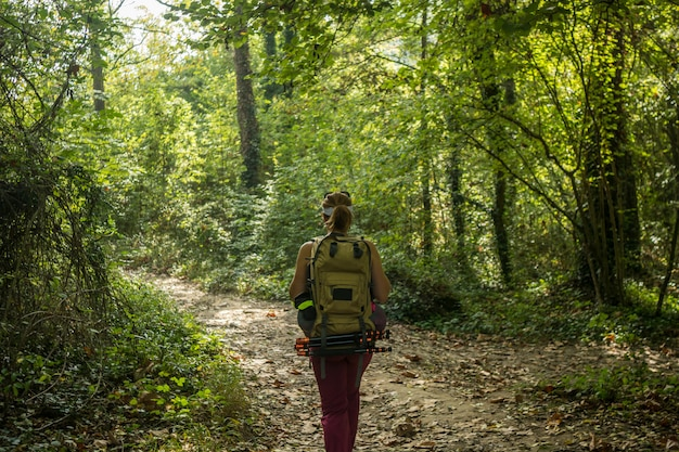 Female athlete to trekking through forests Premium Photo