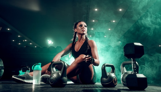 Female athlete with dumbbells at the gym Premium Photo