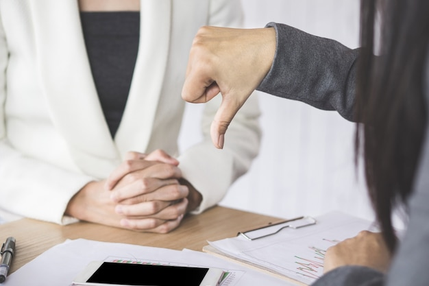 Female boss unhappy and disappointed with the project showing hand dislike to the team Premium Photo