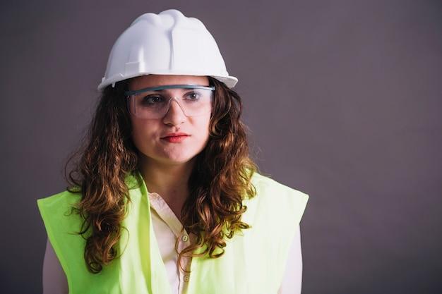 Female builder in helmet Free Photo