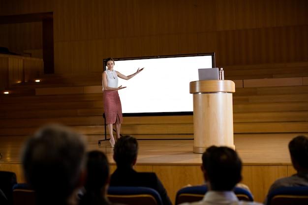 Female business executive giving presentation Free Photo