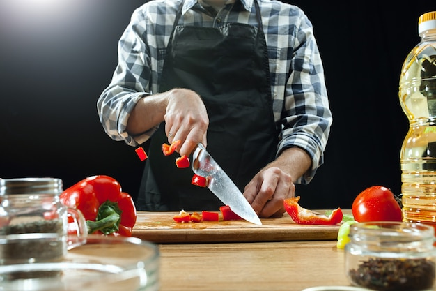 Female chef cutting fresh vegetables Free Photo