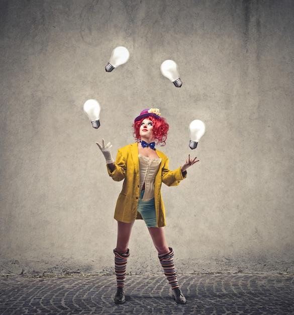 Female clown juggling Premium Photo