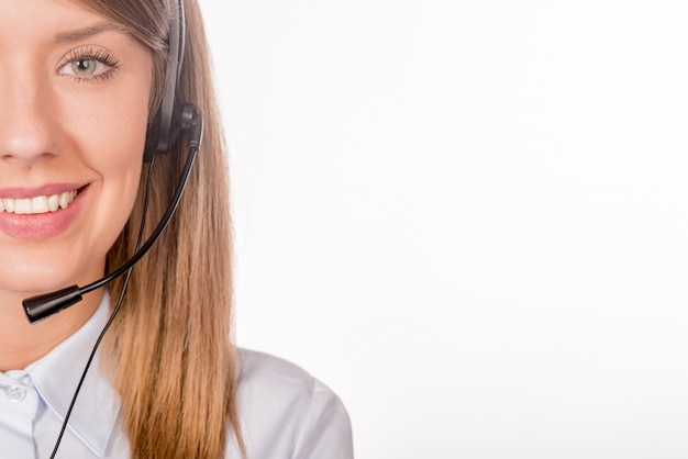 Female customer support operator with headset and smiling Free Photo